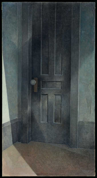 image of a closed wooden, black door