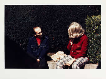 Roberta and unidentified man on bench.
