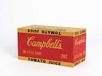 a wooden paint/printed grocery store carton of Campbell's Tomato Juice
