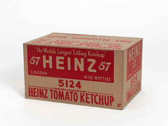 a wooden paint/printed grocery store carton of Heinz Tomato Kethchup
