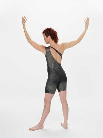 COSTUMES: Black spandex unitards with iridescent sparkled dot texture. Unitards in a variety of...