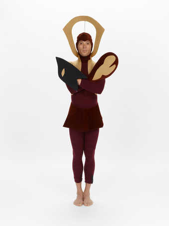 COSTUME: Burgundy/tan wool/ cotton and corduroy body suit. Burgundy corduroy collar. Headdress...