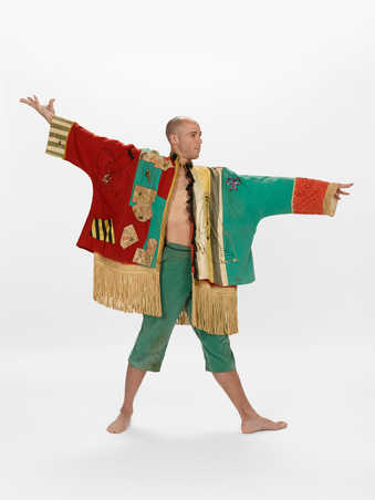 COSTUMES: Oversized coat with patchworks in green and orangey red wool and other patterned...