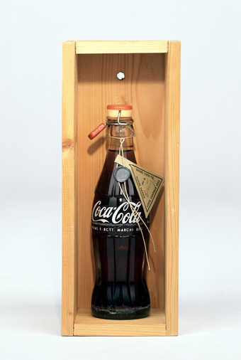 Coca-cola bottle with herb tea, plastic and rubber clamp lid; attached string with lead and paper...