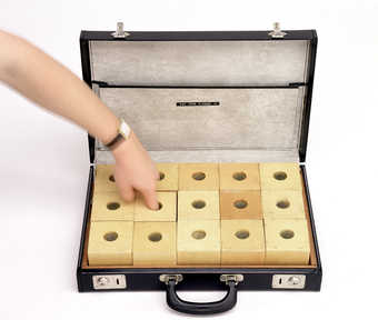15 natural wood finger boxes each containing something different, in a black vinyl briefcase with...
