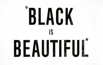 "The words ""BLACK IS BEAUTIFUL"" printed in  black ink from a rubber stamp.  From a suite..."