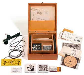 A wooden box containing games, films, fluxus related printed material