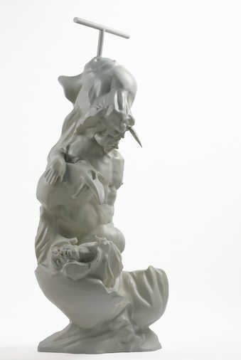 A gray figural sculpture