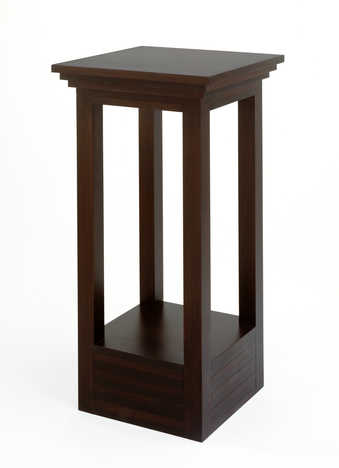 A small table constructed of Mahogany.