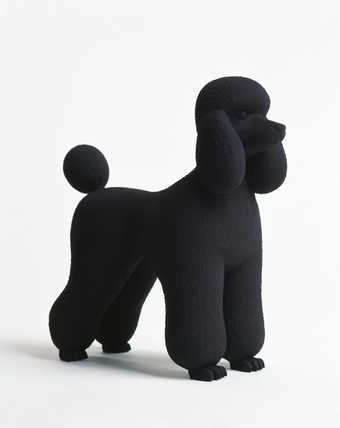 A plaster poodle with a matte black finish.