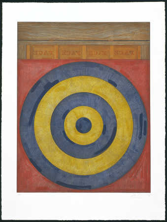 An image of a target printed in yellow and blue on a red square.  Above the red square imabe of...