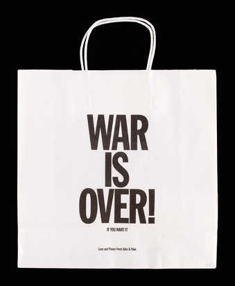 "black text ""War is over if you want it"" in black on a white paper bag from Art Metropole."