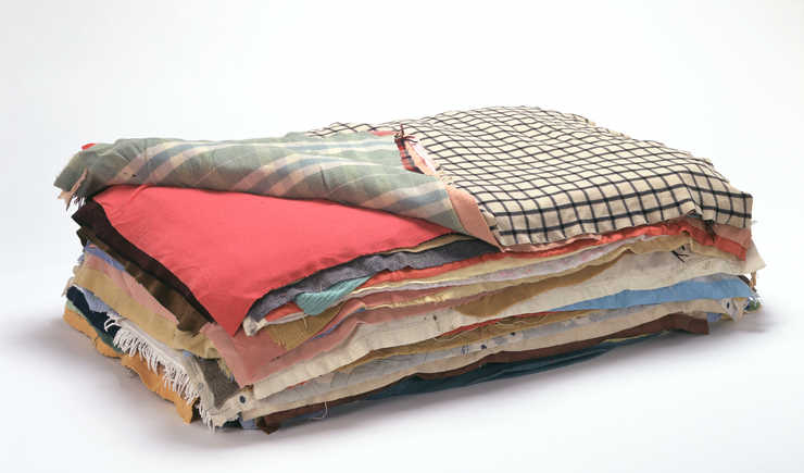 blankets stacked to form a bed