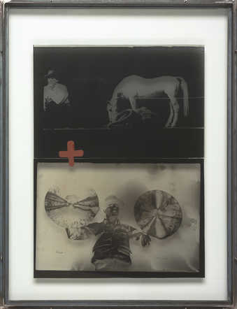a photographic film  negative and a photographic film positive between two sheets of glass...