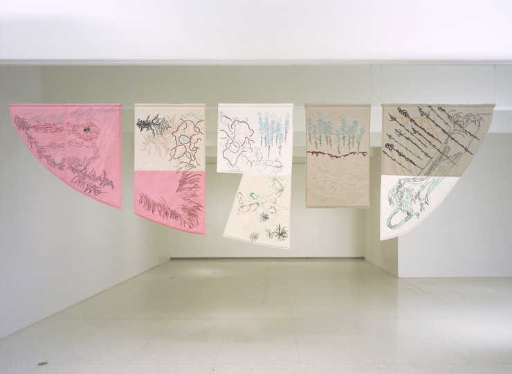 A five part embroidered tapestry, each piece is cut to the shape of a vacant lot is Osaka, Japan