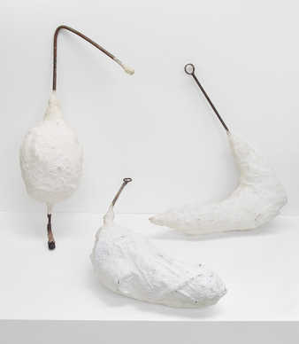 Three white painted epoxy forms pierced with steel rods.  The forms are designed to be carried...