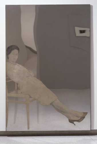 woman reclined in a chair on a mirror like field of stainless steel