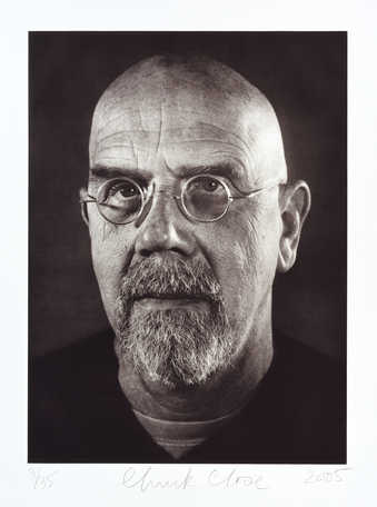 A large black and white self-portrait