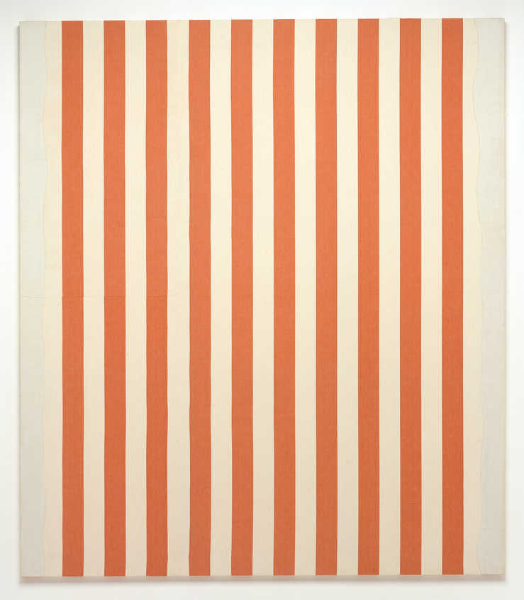 A stretched piece of orange and white striped fabric with white acrylic paint stripes at the left...