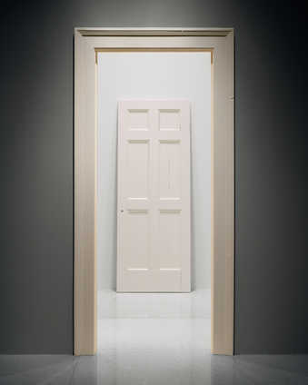 A six panel door and door frame.